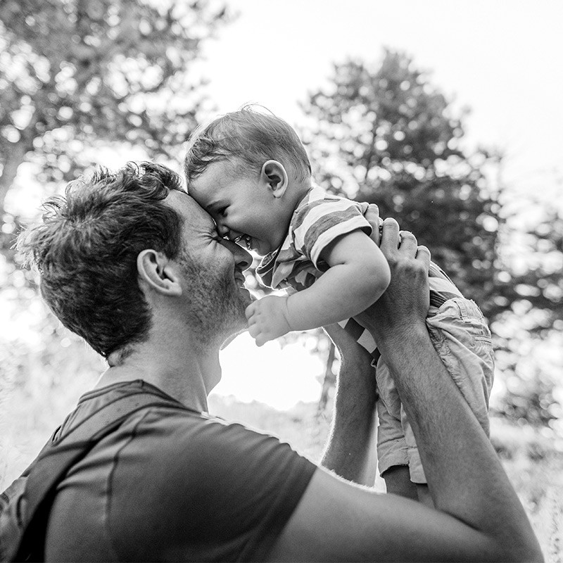 Father holding smiling child